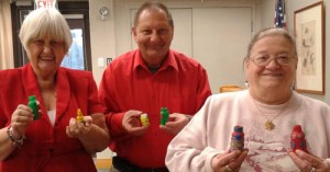 "Lorraine, Richard and Cheryl show off the bottles they made in Sundays ""Bottles of Hope"" workshop."